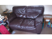 Two worn sofas a three seater and two seater in DEREHAM