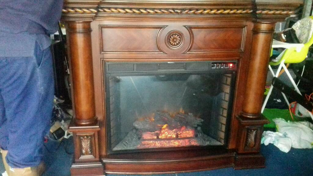 Large electric fire and surround