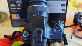 Sony Alpha SLT57 camera body with two lenses.