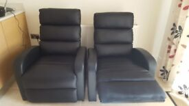 2 Faux Leather reclining chairs