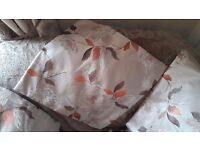 Four floral and leaf design cushion covers.