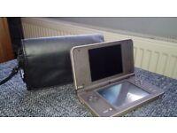 Nintendo DSi XL including case.