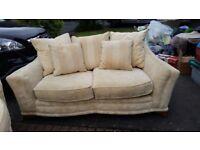 Two 2/3 seater cream fabric sofa