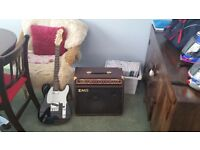 As new electric guitar and amp and cable