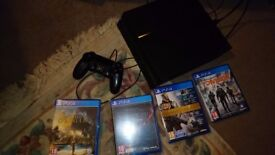 Playstation 4 with 4 games, assassins creed origins, destiny, elder scrolls online, the division.