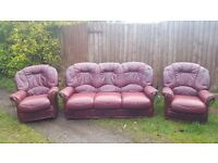 Used 3 piece cherry red leather sofa suite. 3 seater sofa and 2 armchairs.well used. can deliver