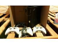 Xbox 360 With 4 controllers headset and 10 games