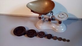 Vintage weighing scales, with a set of weights.