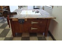 Old school woodworking bench with two record quick release vices and four storage cupboards