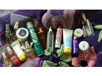 Selection of toiletries; body sprays, perfume, lotion, face cream.