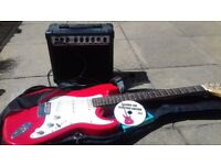 Electric guitar and mains amplifier in case