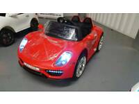 Porsche style 12v ride on kids electric car red brand new boxed with remote control and much more