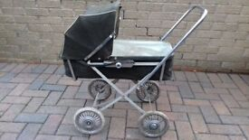 collectable 60's / 70's dolls pram with removable carrycot