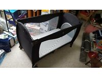 Mimas luxury travel cot and mattress.