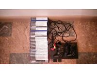 Playstation 2 console with 2 controllers and selection of games