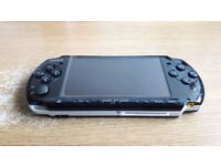 PSP 3000 Piano Black + Sony 4GB memory card + 7 games + case + original charger