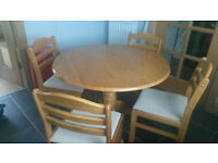 Solid oak dining/kitchen table and four chairs