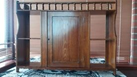 Old oak wall cupboard with shelves.