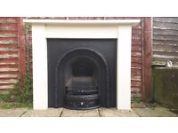 LARGE CAST IRON FIREPLACE AND SOLID PINE SURROUND. LINCOLN.