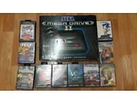Sega Mega Drive II with games