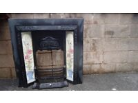 OLD CAST FIREPLACE WITH WOOD SURROUND