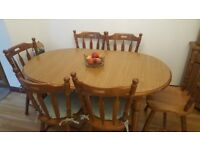 Oak dining room table and chairs set