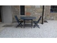 Solid wooden garden furniture painted grey. Table 120 cms wide & 2 chairs