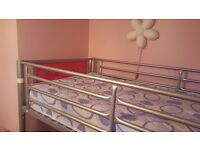 Like new Metal high sleeper with desk. Great condition, hardly used.