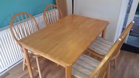 Pine table with four chairs, includes extension to seat 10