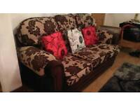 Two piece suite, three seater sofa, one chair + cushions