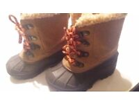 Kids snow boots from next hardly worn open to offers has nice fur in them to keep them warm thanks