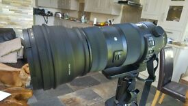 sigma 150 -600 sport lens Canon fit. 1.4 converter and docking station.