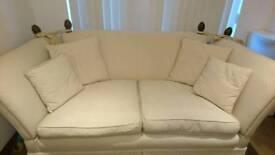 Laura Ashley sofa, cream. Castors and finials