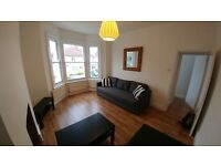Spacious two bedroom first floor flat with garden