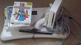 Nintendo wii with board and games