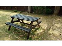 Solid wood garden bench. Varnished every year. Seats 6-8 adults