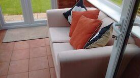 Two cream, two seater sofas