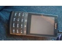 Nokia x3-02 mobile phone with charger
