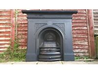 VERY LARGE CAST IRON FIREPLACE IN EXCELLENT CONDITION.