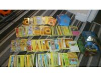 Tin of pokemon cards and sleeves