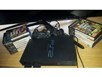 BARGAIN, PLAY STATION 2 PLUS 2 CONTROLS , PLUS ABOUT 20 GAMES, ONLY 35 POUNDS FOR ALL.