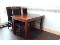 A quality wooden dining set from a smoke free home in good condition general ware 80 cm/120cm H77