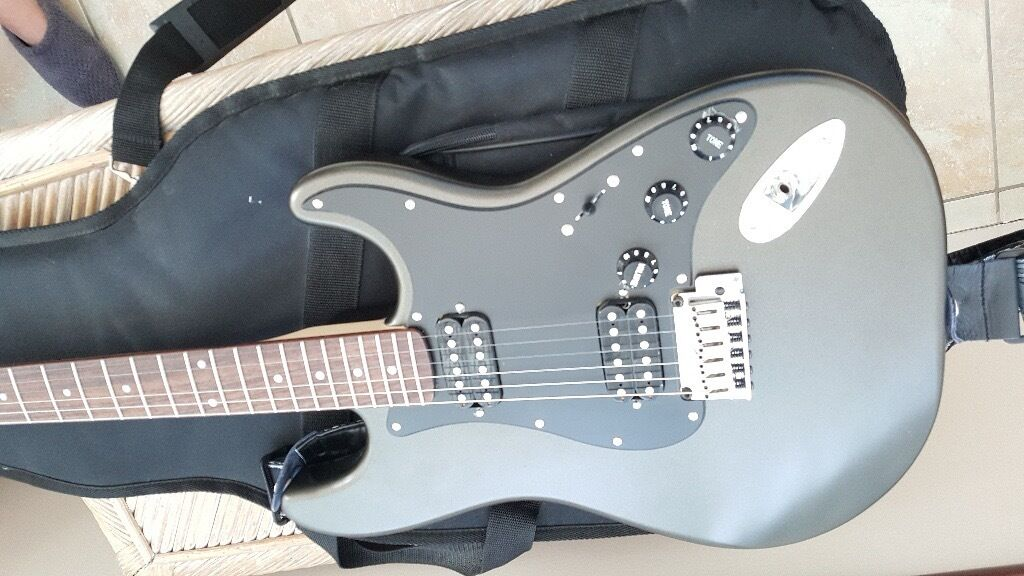 Fender Stratocaster Squier with cary case & Spider 15 watt amp. As new