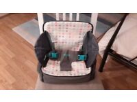 Multi function 3 in 1 travel booster seat with feeding and changing features.