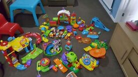 bundle of toys including toot toot