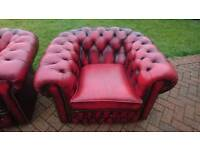 An ox blood red leather Chesterfield club chair in good condition throughout