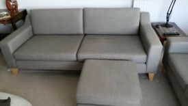 Lounge suite. 2 seater and 3 seater sofa and pouffe. Grey/ brown /black designed by Jimmy Thompson.