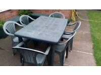 6 garden chairs and table, and telling chair