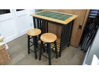 Kitchen table and stools , Green Tiled top .