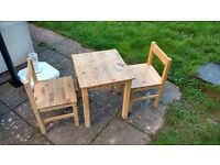 Wooden kids table and two chairs